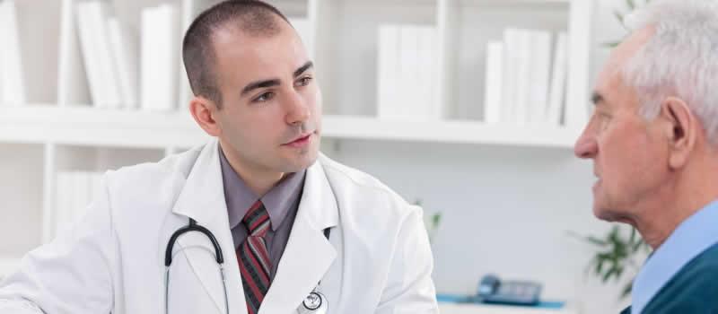 Doctor talking to an elderly patient