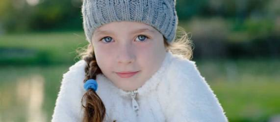 Young girl in coat and bonnet