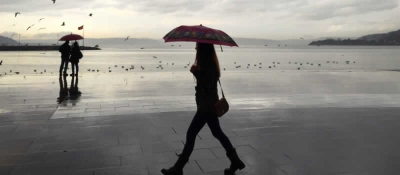 woman with umbrella walking